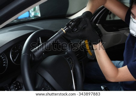 Cleaning of  interior of the car hot steam - stock photo