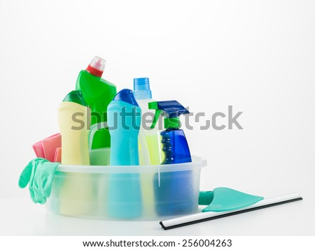 cleaning products in basket on white background - stock photo