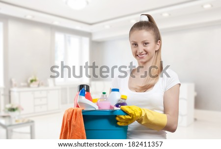 Cleaning service, woman with detergent  - stock photo