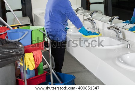cleaning sink with duster - stock photo