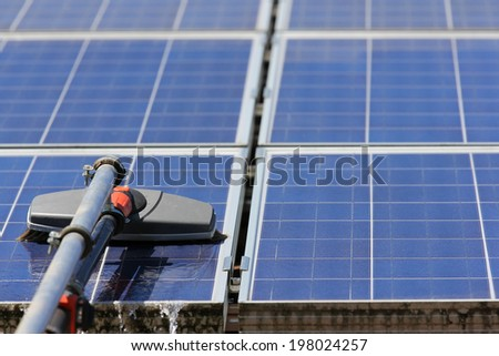 Cleaning solar panels - stock photo
