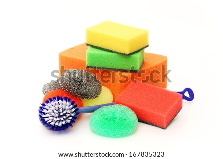 Cleaning sponges and plastic brush on a white background - stock photo