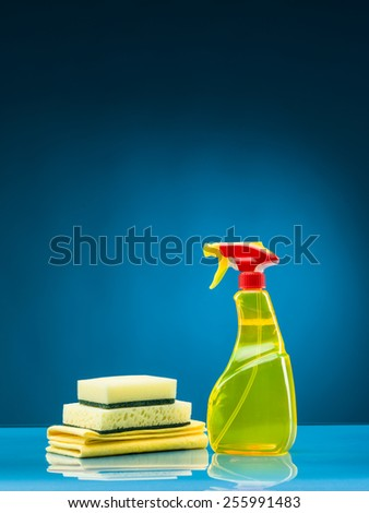 cleaning supplies against blue background - stock photo