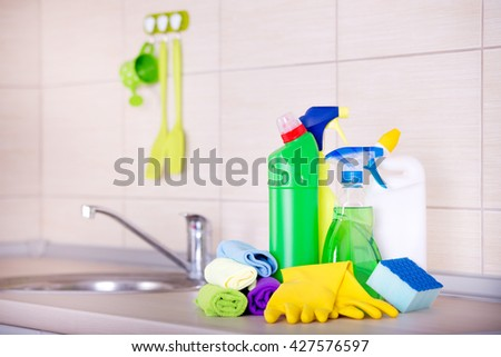 Cleaning supplies and equipment on the kitchen countertop - stock photo