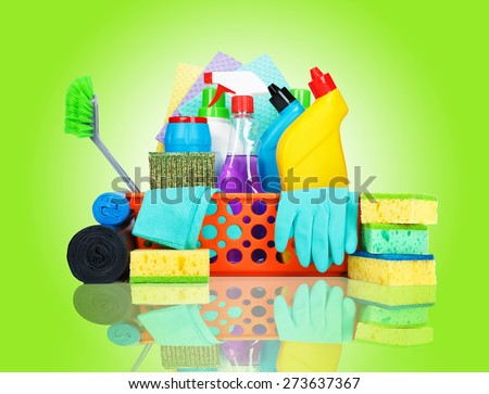 Cleaning supplies in a basket - cleaning and housekeeping concept - stock photo