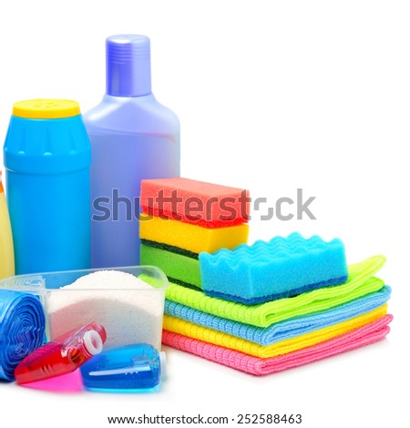 Cleaning supplies, sponges, cleaning powder and garbage bags isolated on white - stock photo