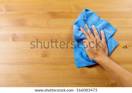 Cleaning table by hand - stock photo