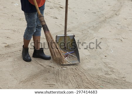 Cleaning the beach within a volunteer event for community environment saving. - stock photo