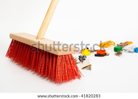 Cleaning the modern red broom mixed trash - stock photo