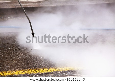 Cleaning the streets with water pressure - stock photo