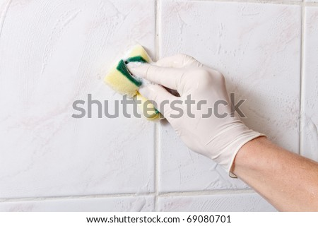 Cleaning wall. - stock photo