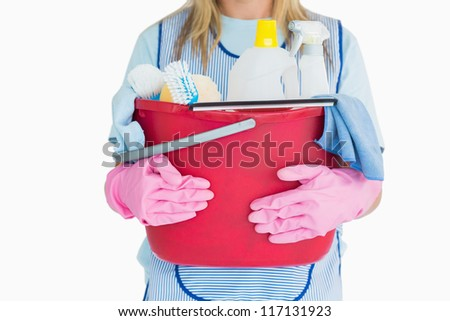 Cleaning woman holding a bucket of cleaning supplies in the white background - stock photo