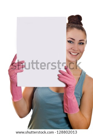 Cleaning woman showing a white paper on the white background - stock photo