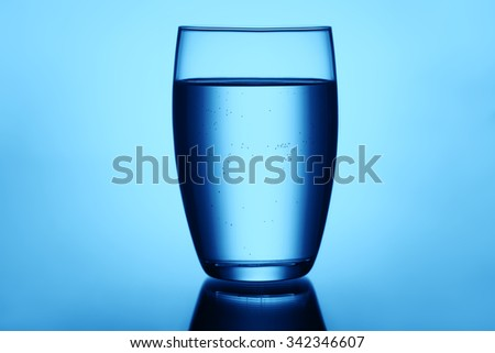 Clear and full glass of water - stock photo