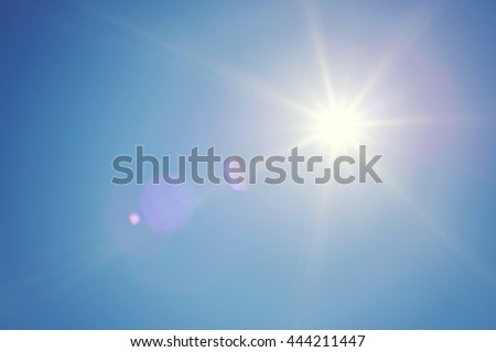 Clear blue sky and sun. Sun rays. Concept of energy, happy, weather forecast or religion. Shiny daylight. - stock photo