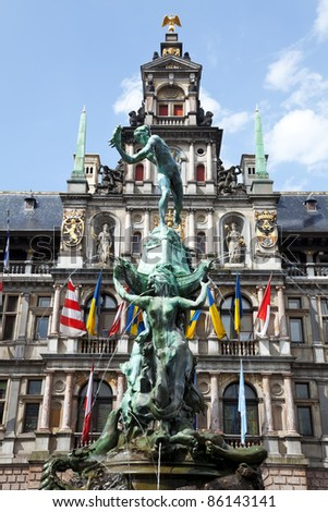 Clear, blue sky, Antwerp's Town Hall and the fountain in front. - stock photo