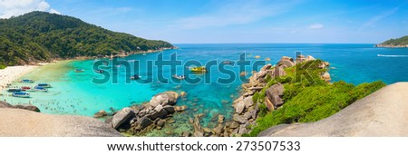 Clear, blue waters under a clear, blue sky on this beautiful, white-sand, tropical beach in the Similan Islands of Thailand, Southeast Asia. - stock photo