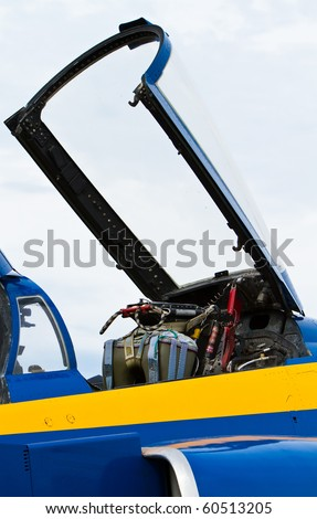 Clear canopy raised on a jet at a airshow - stock photo