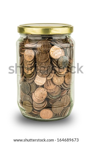 Clear glass full of American Pennies symbolizing economy and savings. - stock photo
