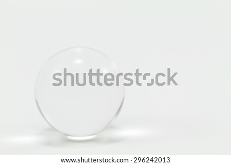 Clear glass marble isolated on white background - stock photo