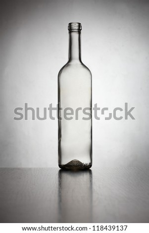 Clear glass wine bottle isolated on white - stock photo