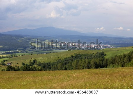 Clear green Landscape with Village Namestovo from the summer Mountains Magura in Slovakia - stock photo