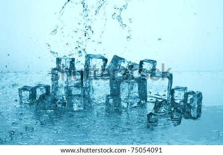 Clear ice and splashing water - stock photo