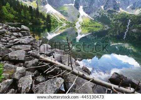 clear lake among mountain ranges - stock photo
