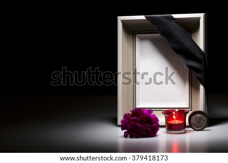 clear mourning frame with flower and candle for sympathy card - stock photo
