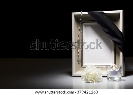 clear mourning frame with flower and candle on dark background - stock photo