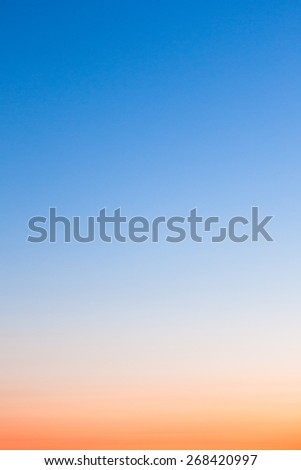 Clear orange and blue sunset sky - stock photo