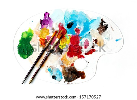 Clear Palette and brushes for acrylic painting - stock photo