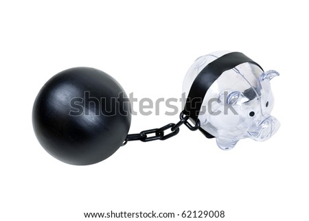 Clear piggy bank used to save change for a future purchase held by a ball and chain - path included - stock photo