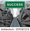 Clear strategy and financial planning road with a green highway sign and the word success as a business concept of winning solutions cutting through adversity as tangled paths of confusion and chaos. - stock photo