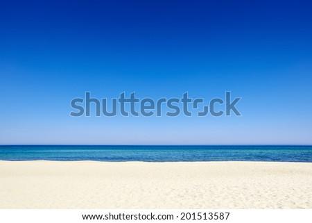 Clear sunny summer blue sky sea coast beach sand background copyspace. - stock photo