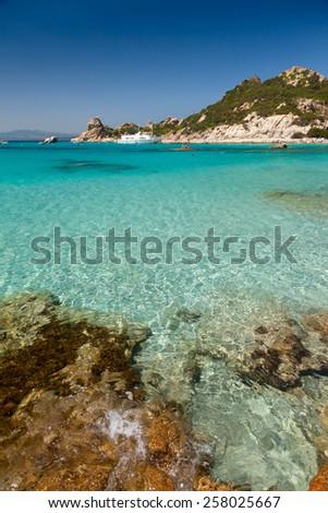 Clear turquoise water of Cala Corsara cove at Maddalena Archipelago in Sardinia - stock photo
