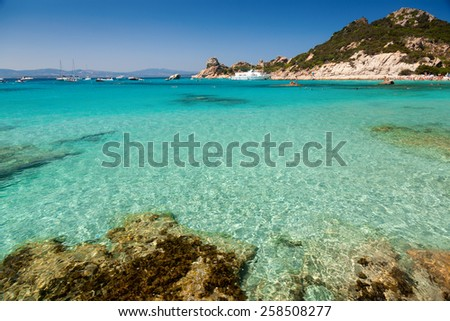 Clear turquoise water of Cala Corsara cove at Maddalena Archipelago in Sardinia - stock photo