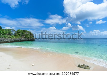 Clear turquoise water waves gently lapping on tropical paradise beach, Ishigaki Island National Park of the Yaeyama Islands, Okinawa, Japan - stock photo