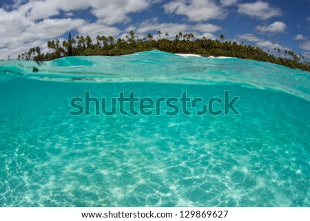 Clear, warm waters bathe the shore of Isle de Mare, near New Caledonia in the South Pacific Ocean.  This beautiful island also harbors diverse reefs. - stock photo