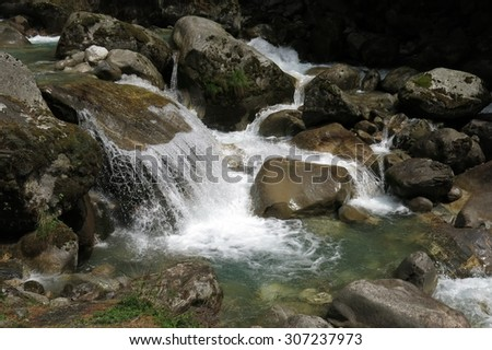 Clear water of a creek in the Everest Region - stock photo