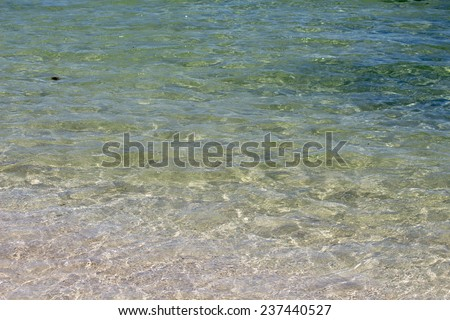 Clear water of the Indian Ocean at Hutt's beach near Bunbury western Australia on a hot summer afternoon. - stock photo