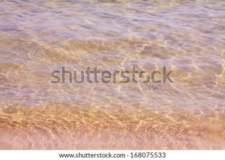 Clear water with sand beach. - stock photo