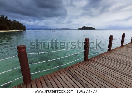 Clear waters and the jetty at Manukan island, Borneo, Sabah, Malaysia - stock photo