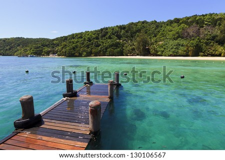 Clear waters at the dock. Manukan Island at Borneo, Sabah, Malaysia - stock photo
