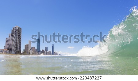 Clear waves rolling on Surfers Paradise beach on Gold Coast, Australia - stock photo