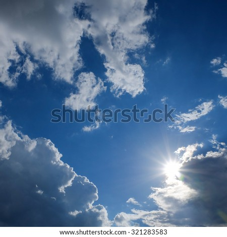 clear weather sky, sun on blue sky with clouds, sun rays, solar of clean energy power - stock photo