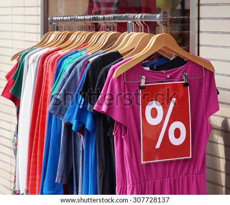 clearance sale clothes rack with a selection of fashion for women  - stock photo