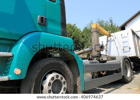 Clearing a Trailer in front of a house - stock photo