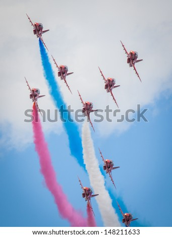 CLEETHORPES, ENGLAND JULY 28TH: Royal Air Force Red arrows perform an aerobatic display at Cleethropes airshow on 28th July 2013 in Cleethorpes England. - stock photo
