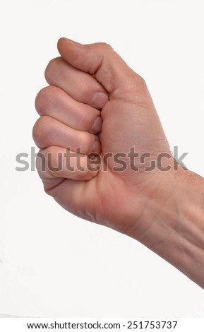 clenched fist hand closeup on white background. Closed hand. - stock photo